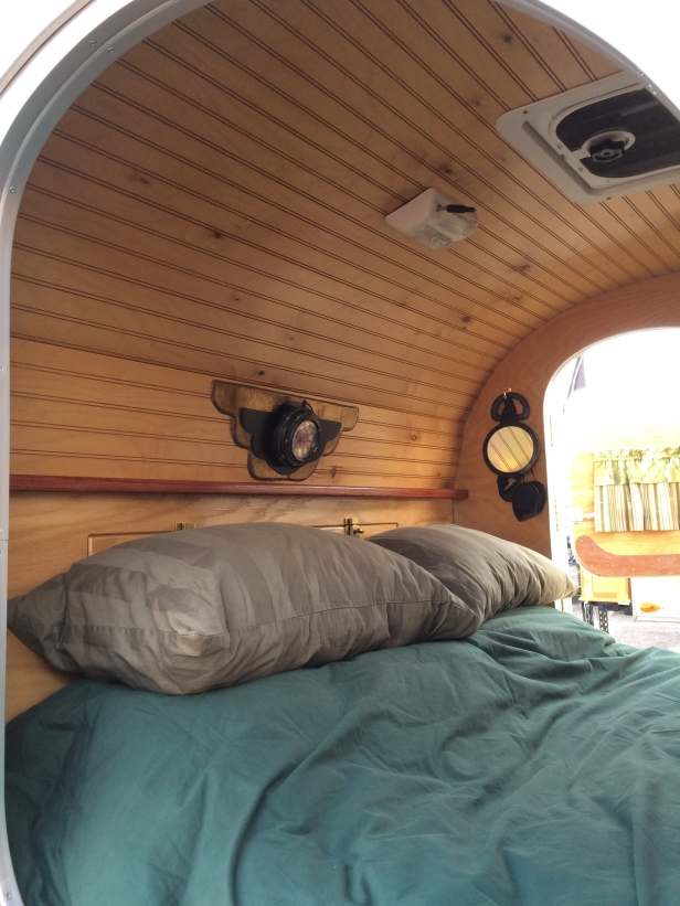Headboard area of our home-built, custom teardrop trailer.