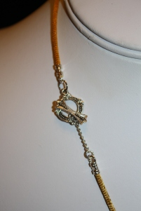10) Butterfly and Mushroom Necklace on Gold Silky Cord close up clasp
