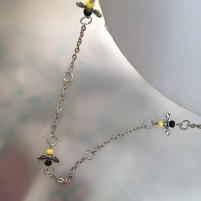 9) Close-up on extra long bee necklace